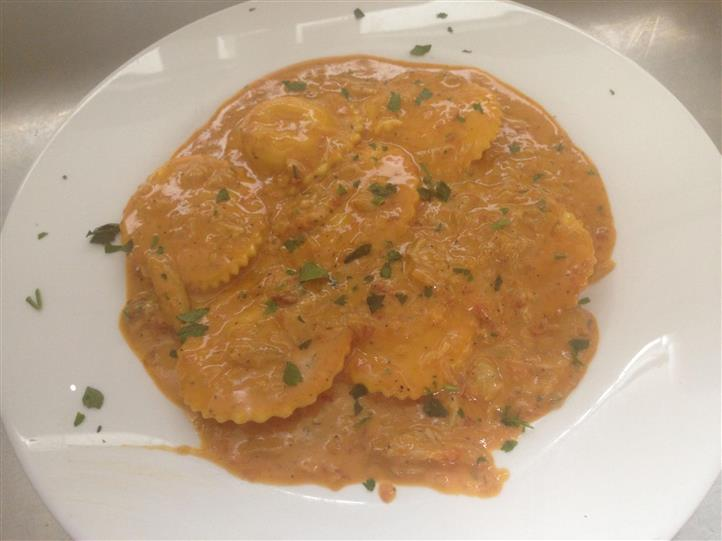 raviolis in sauce with herbs