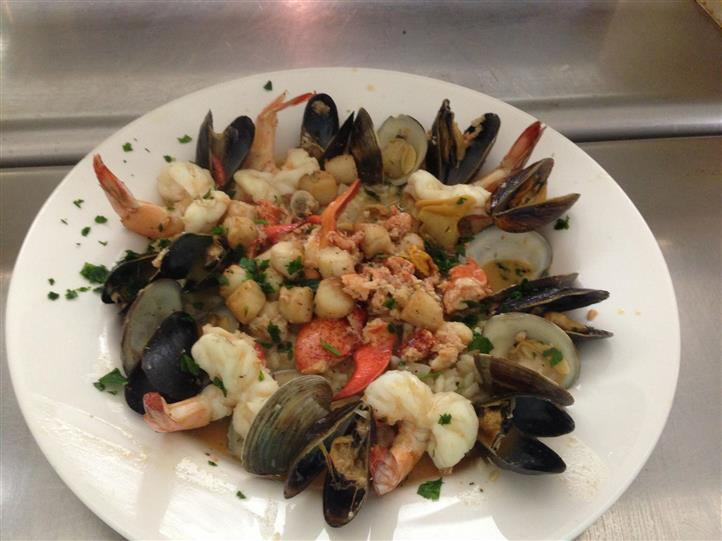 seafood entree with cooked shrimp, mussels and clams