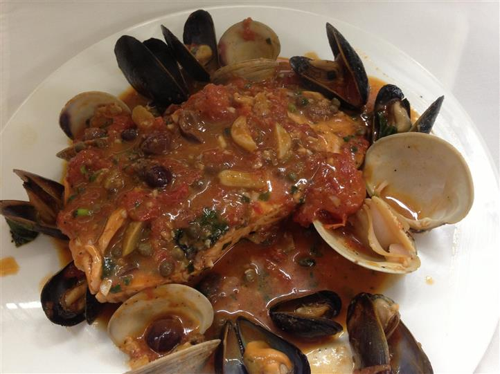cooked mussels and clams in sauce