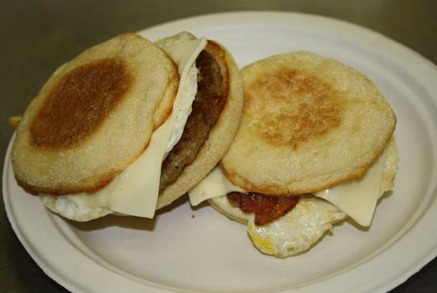 Breakfast sandwich on an english muffin with egg and cheese