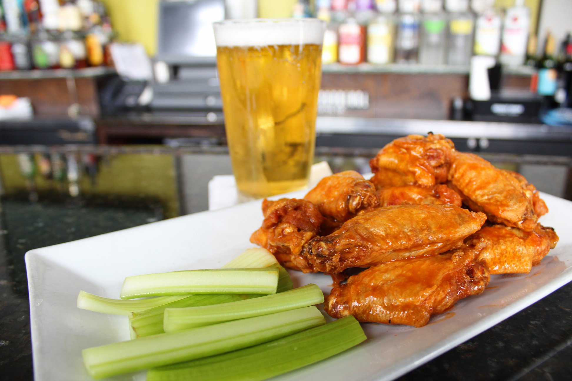 chicken wings and celery with a beer