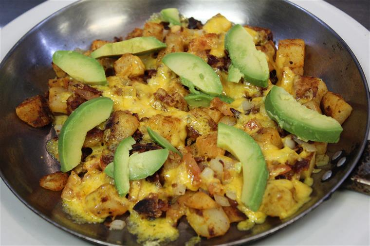 egg and cheese skillet scramble with avocados