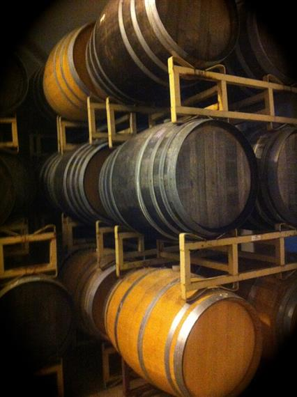 Wooden barrels on a rack