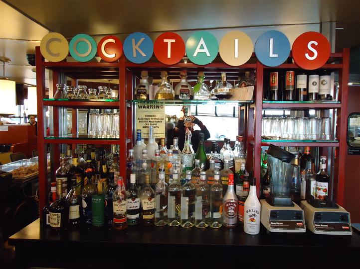 "Bar area with sign that reads ""COCKTAILS"""