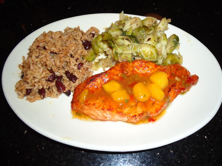 Fish, Vegetables, with rice and beans on a plate