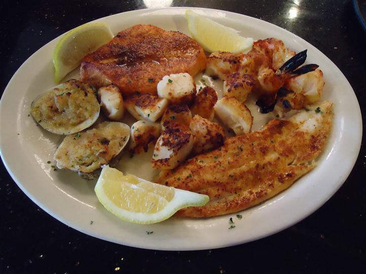 Cooked fish on a plate with lemon on the side