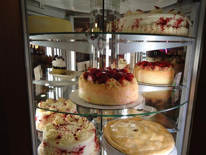Cakes and pies on a  glass display