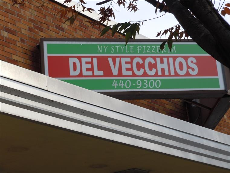 Del Vecchios sign on building - New York Style Pizzeria, Del Vecchios. 440-9300