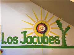 interior front wall with los jacubes logo