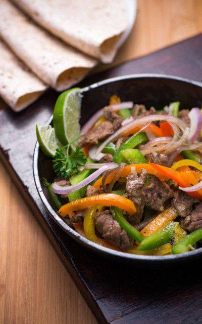 beef stir fry in a skillet with vegetables