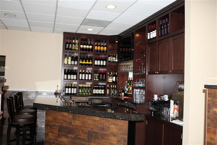 interior bar area showcasing wine and liquor bottles along the wall