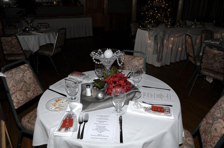 tables setup with napkins, utensils and flower centerpieces