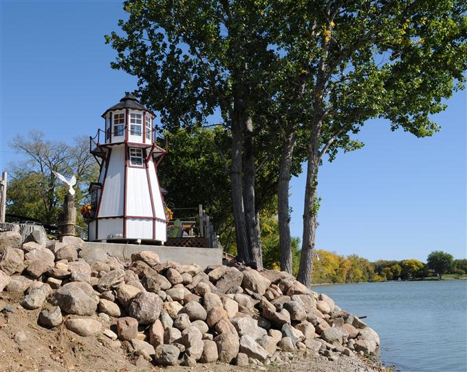 small lighthouse decoration near a lake