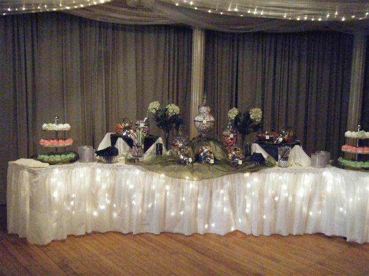 catering display table with small desserts and flowers