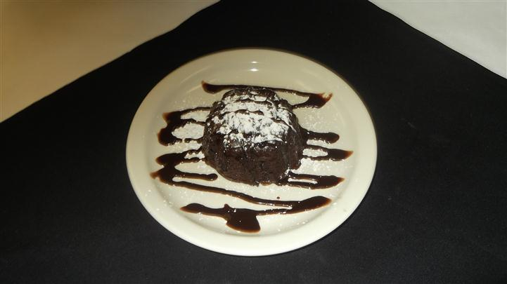 chocolate cake dessert with syrup on a plate