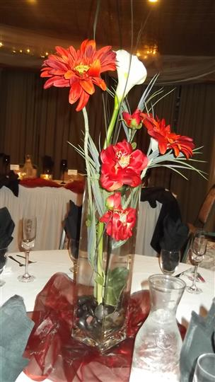 large flower centerpiece in the middle of a table