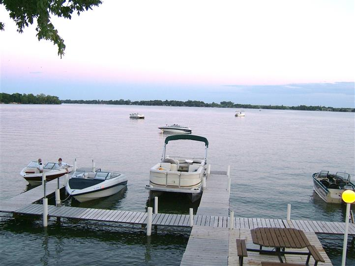 dock on a lake with boats in the water