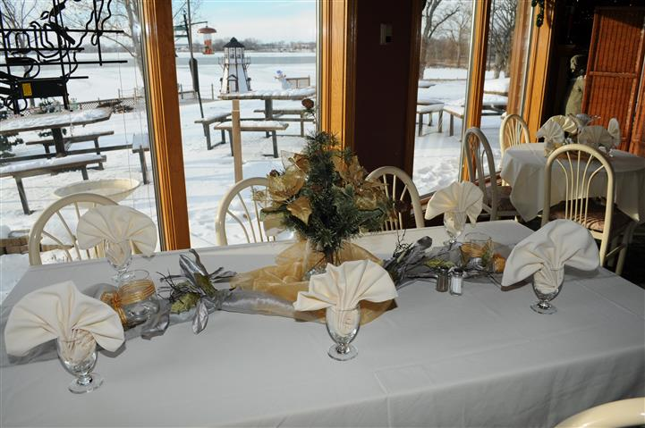 dining area setup during the winter time with napkins and utensils