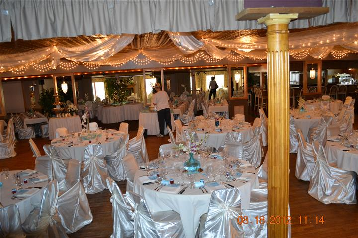 dining area setup for an event with tables and chairs