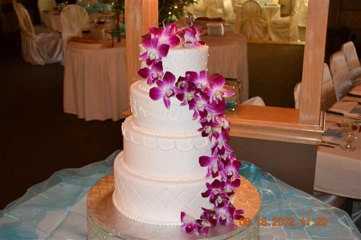 four tier cake decorated with flowers
