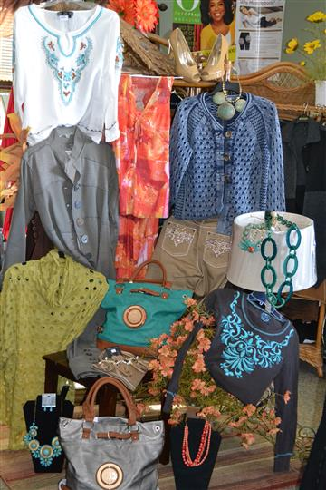 assortment of clothing for sale, hanging for display