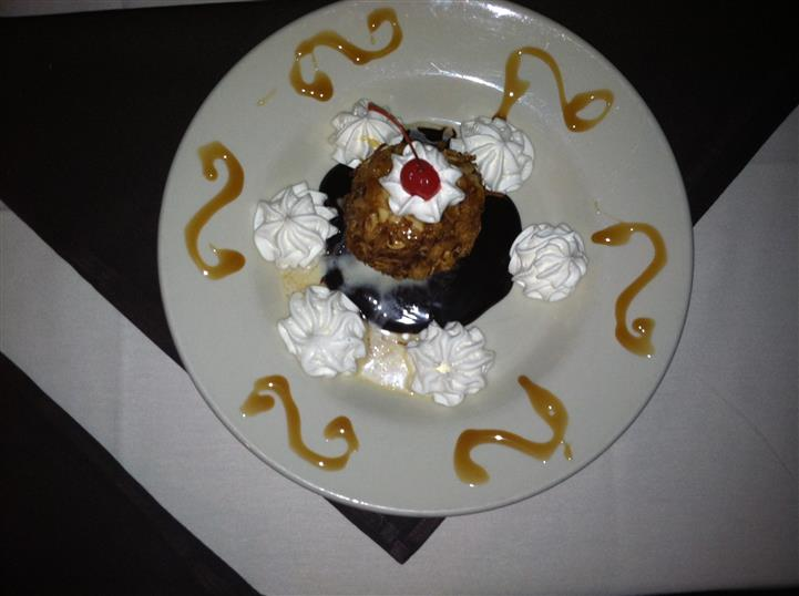 chocolate dessert on a plate with whipped cream