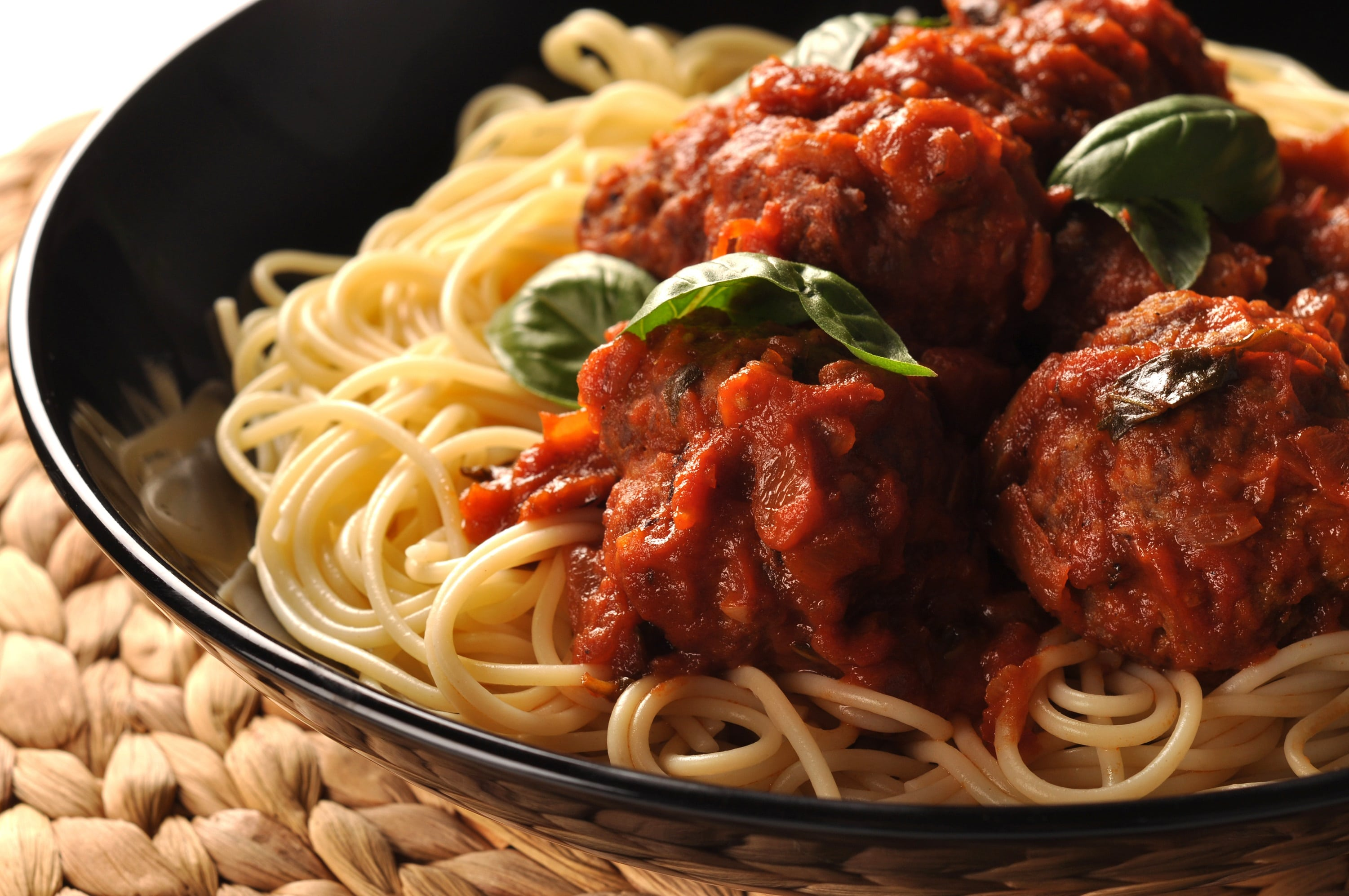 spaghetti and meatballs topped with tomato sauce