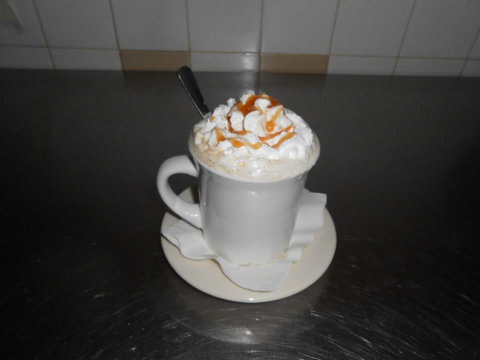 cappuccino with whipped cream and caramel syrup