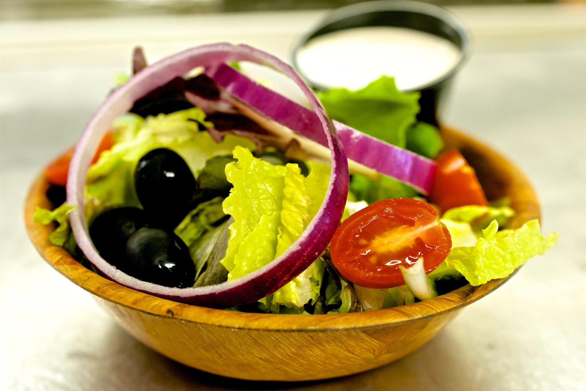 garden salad with lettuce, tomatoes, onions and olives