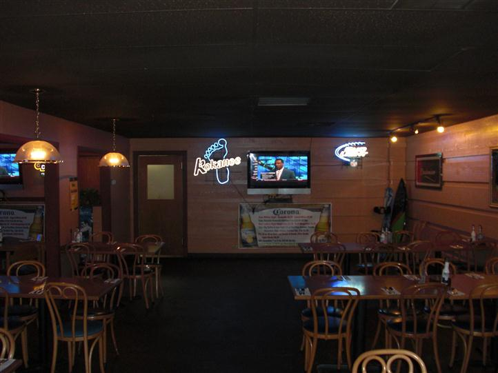 inside restaurant with television on the wall