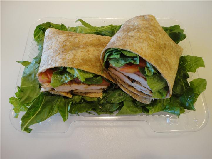 Wrap cut in half, over leafy greens
