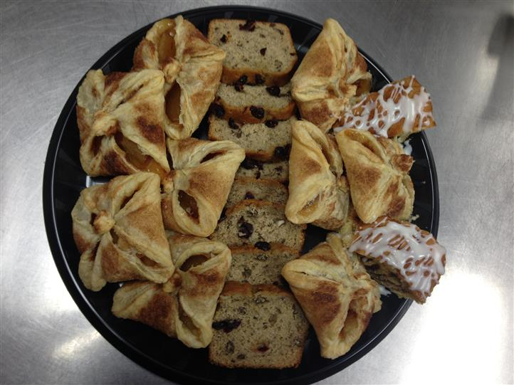 A tray with pieces of cake and pies