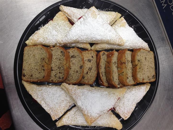 A cartering tray with pieces of pies and cakes