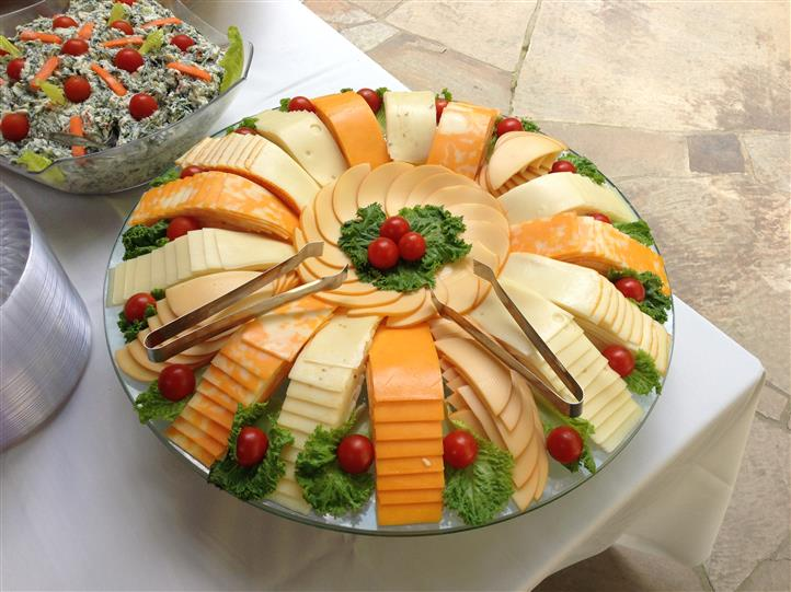 A decorated tray of cheeses