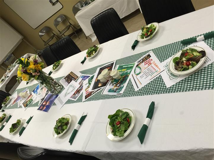 A table in green and white tablecloths