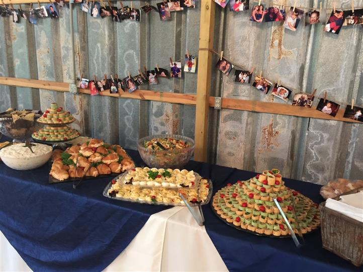 An interior buffet with several catering trays