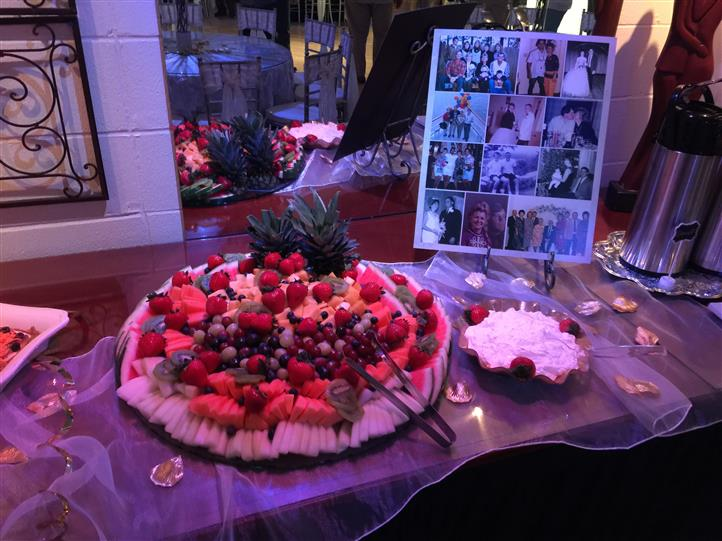 An interior buffet with a fruit salad tray