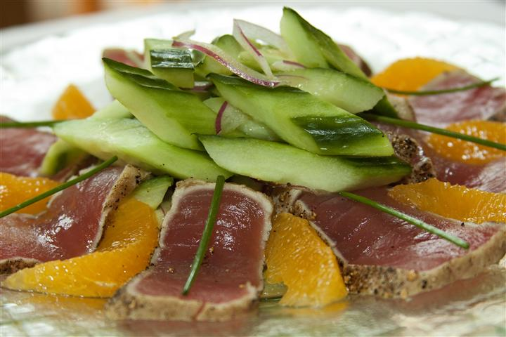 ahi tuna slices with cucumber and oranges