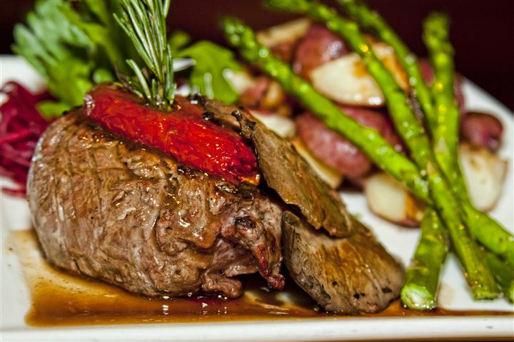 cooked steak with asparagus and potatoes
