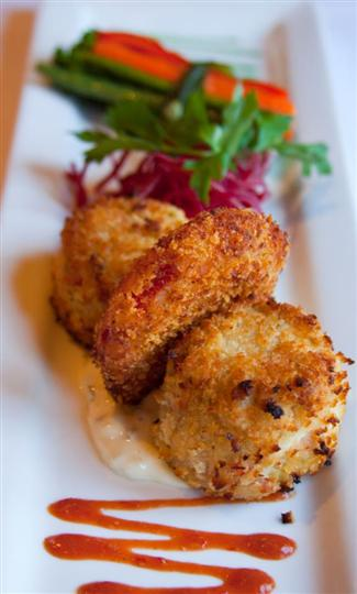 fried scallops with sauce and herbs