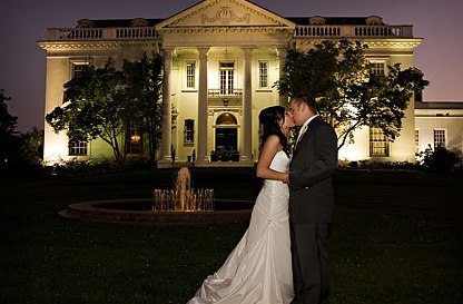 Husband and Wife Kissing infront of The Old Governor's Mansion