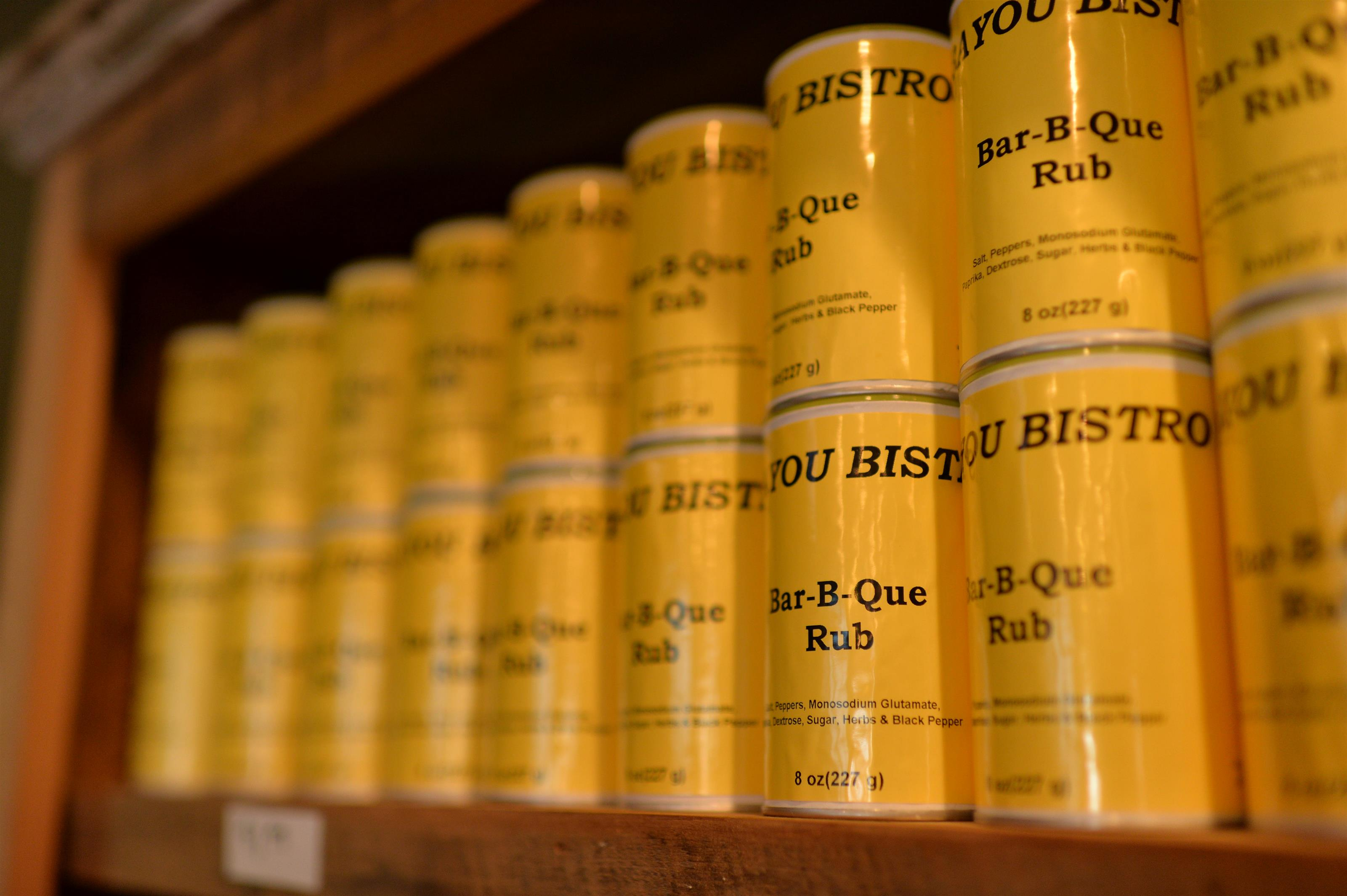bayou bistro bar-b-que rub lined up on a shelf