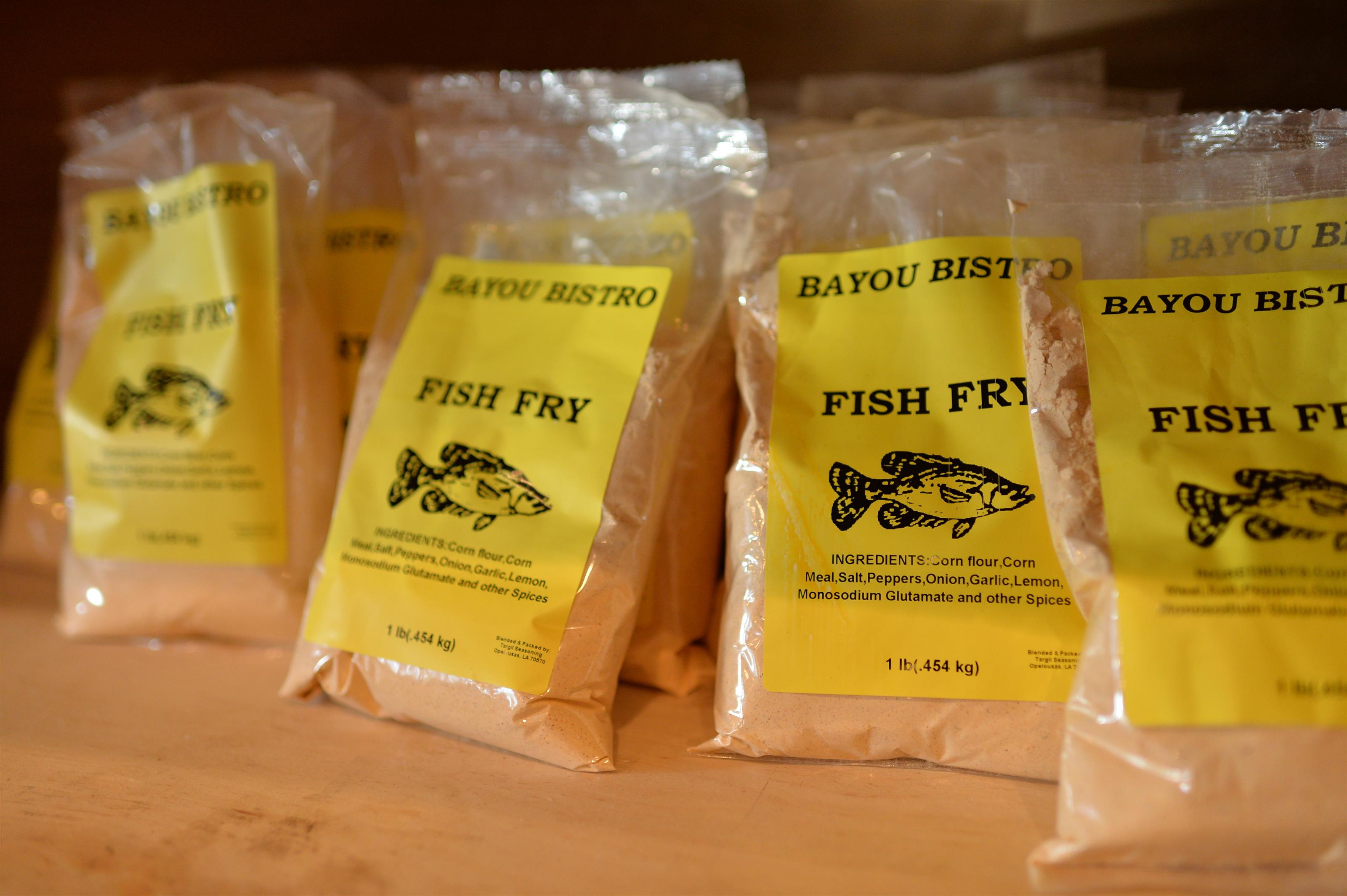 bayou bistro fish fry bags lined up on a shelf