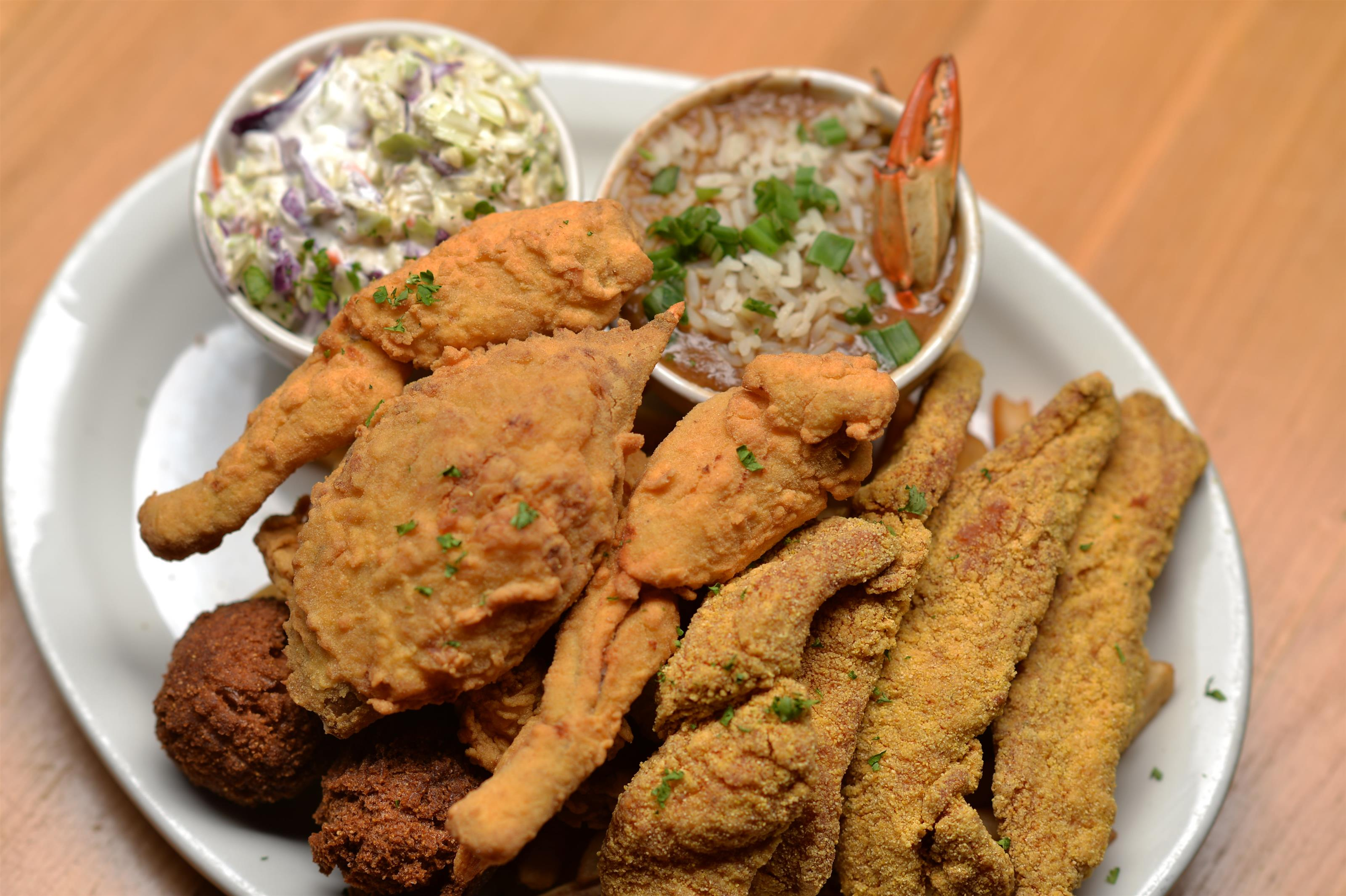 fried chicken and seafood served with coleslaw