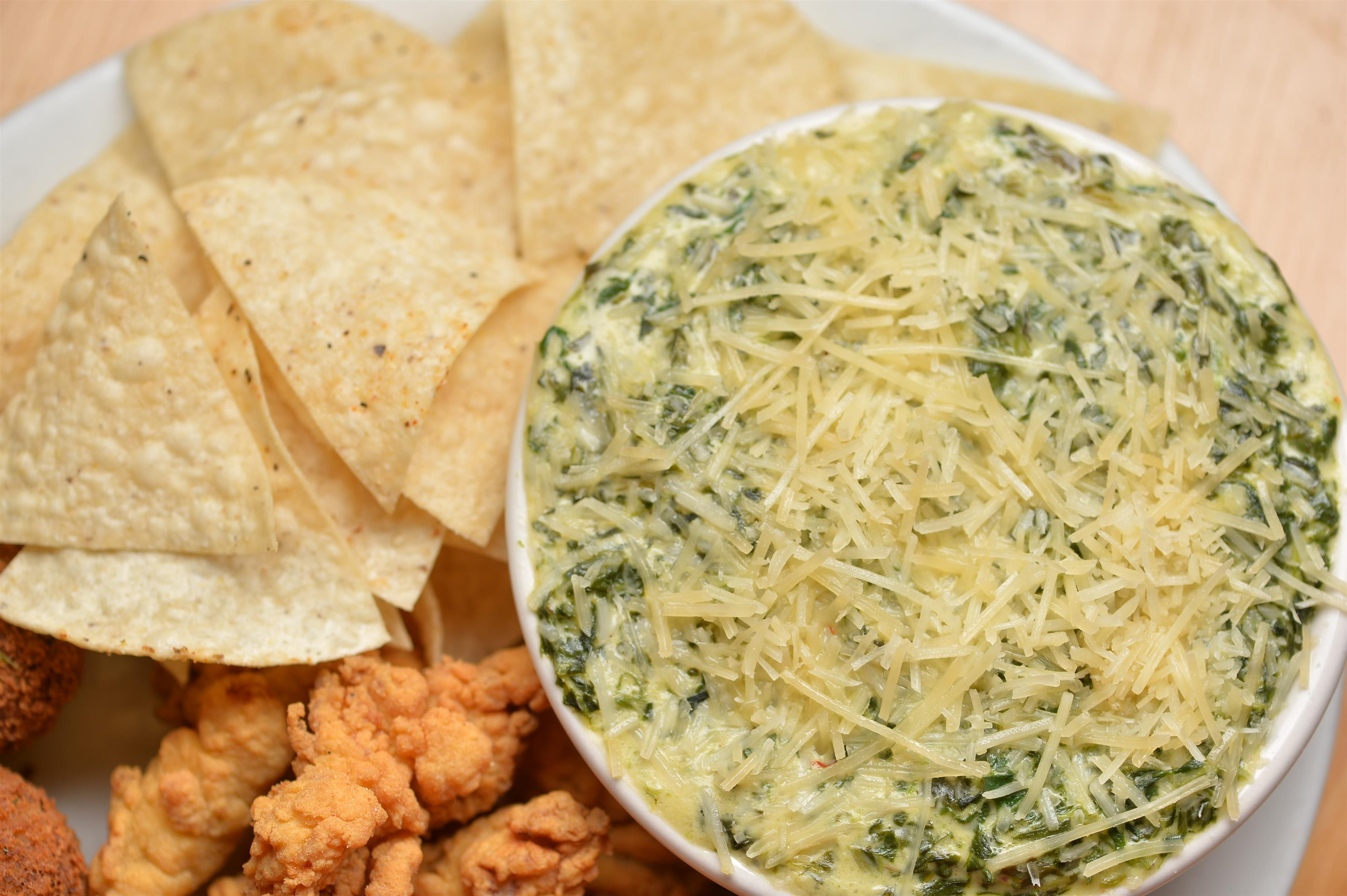 spinach dip and chips with popcorn chicken