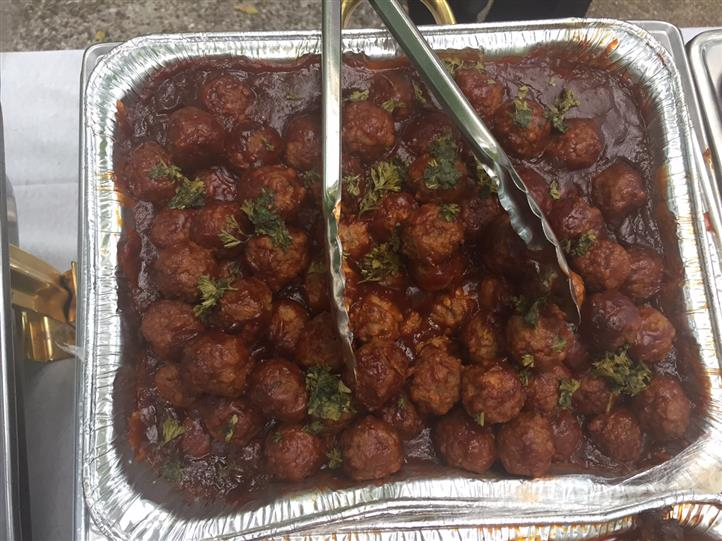A meatballs tray with meat sauce