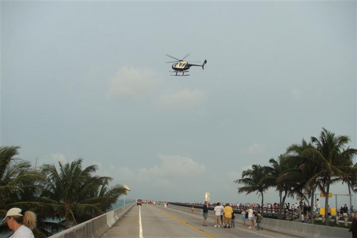 helicopter flying over road