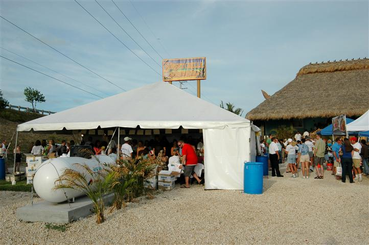outdoor tent with people gathering
