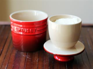 Le Creuset Butter Crock on wood table