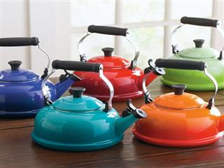Le creuset tea kettles on wood table
